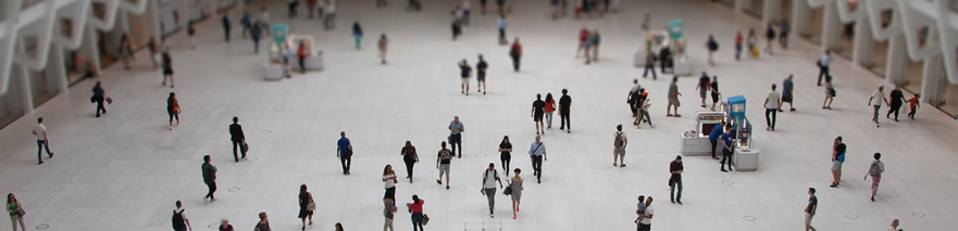 Detail of photo by Alessandro Melis on Unsplash - people in building from a distance