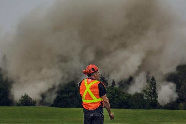 construction_man_in_front_of_smoke