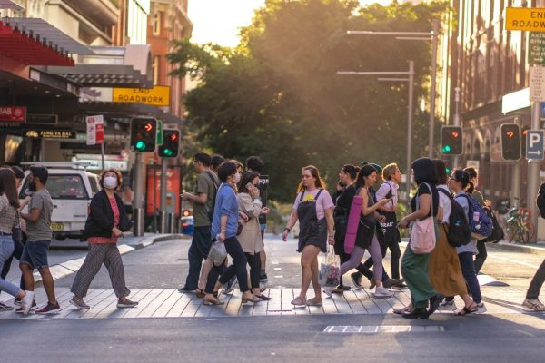 Sydney people with face mask covered crossed street in city, Covid 19 sickness outbreak situation in Australia, Sydney: 19-03-2020